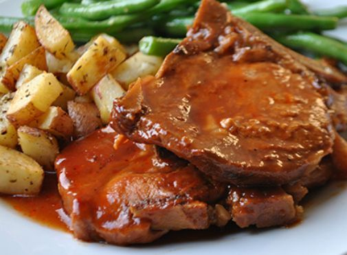 """Slow Cooker BBQ Pork Chops ~~~ Do you have a """"go to"""" Pork Chop recipe? This one is mine. I love making pork in the slow cooker because it gets fall-off-the-bone tender. This recipe for Slow Cooker BBQ Pork Chops is no exception! You will also enjoy the unique flavors in the special sauce – a twist on your typical BBQ sauce."""