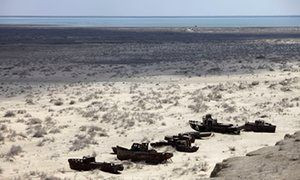 Aral Sea - salty wasteland, abandoned fishing boats, and ruined the local economy.