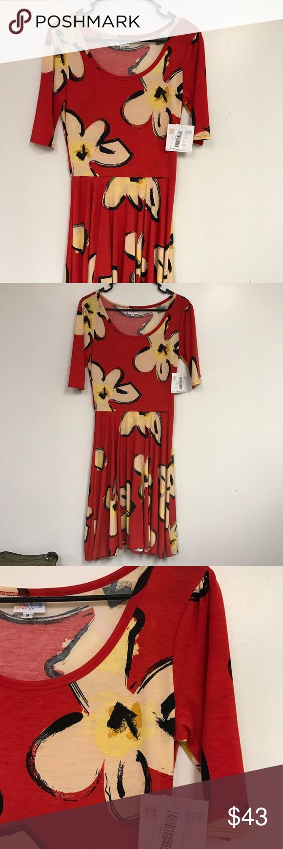 LLR Small Nicole NWT Beautiful red floral Nicole. NWT. Dog and cat friendly home. Non smoker. Perfect for tropical vacation. LuLaRoe Dresses