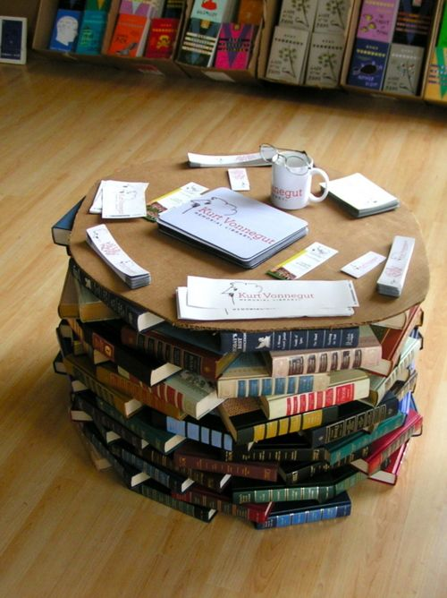 "Not coffee table books…coffee table of books  booksloveback:    twilightdew:    ""We used a table made of books at the Kurt Vonnegut Memorial Library in Indianapolis."" -CoreyMDalton  Image Credit: CoreyMDalton    OH OH OH OH OHHHHH this is too much for me.  Beautiful."