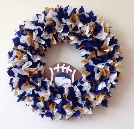 GSU theme handmade fabric wreath in blue, white and a splash of gold. Hang it up inside for football season or show off your team spirit on your