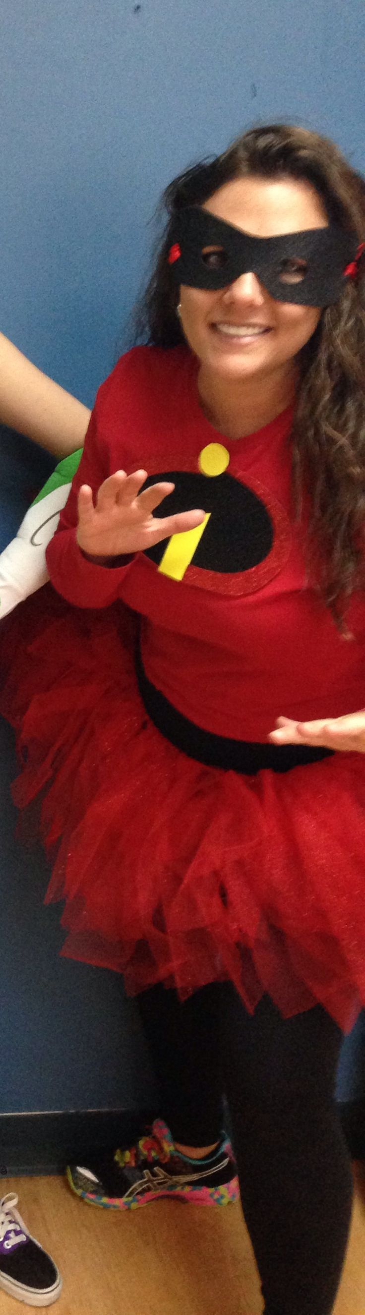 ElastaGirl aka Mrs. Incredible - cheap costume. $3 for the tutu and $3 for the foam glitter paper for the logo! Workout pants and shirt.