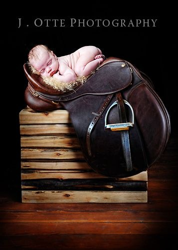 Jodie otte photography baby on saddle