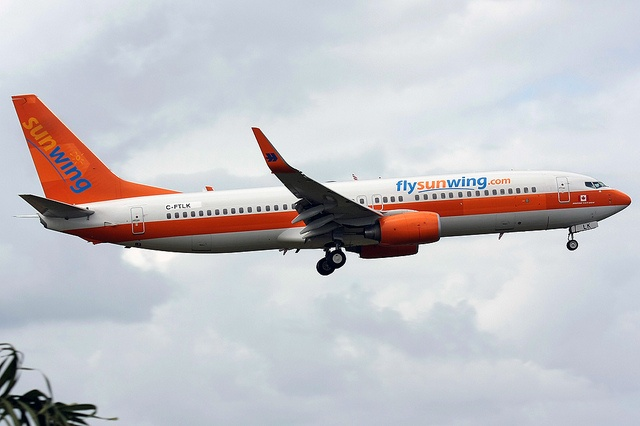 Sunwing Airlines Boeing 737-8K5; the livery indicates that the aircraft flew for German Hapag Lloyd before which after decades got re-branded as TUIfly. While the blue logo on tail fin got removed the outer winglets still display the former logo of the German carrier