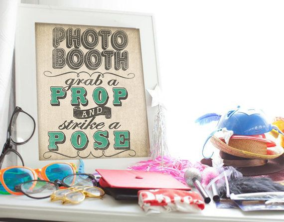Perfect photo booth sign! We are making our own photo booth, so this will help guests get started. Plus you can customize the colors! Wedding Photo Booth Sign with Burlap and by DesignerCanvases, $12.00