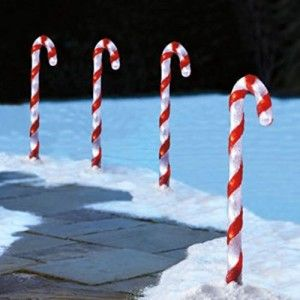 Candy Cane Pathway Lights These candy cane pathway lights provide a fun and festive addition to an outdoor holiday display.