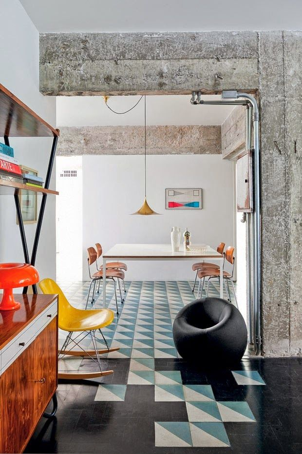 what a fun living room with pops of color and funky tiling.