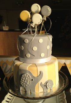 Yellow and gray layer cake at an elephant baby shower!   See more party ideas at CatchMyParty.com!  #partyideas #babyshower