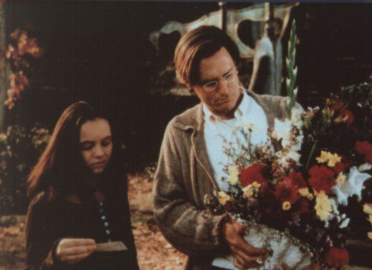 Arrival at Whipstaff --  In the original movie, Carrigan hands Dr. Harvey a bouquet (BOOquet!) of flowers, and after Dibs wishes a lovely night, the next scene follows. According to the book and this picture, the scene continues to show Kat discovering a small card between the flowers with condolence wishes...