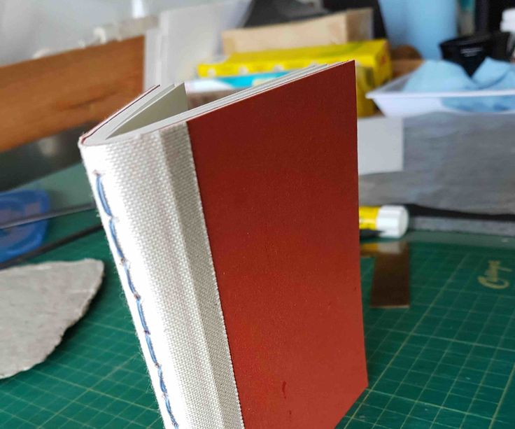 The structure of one of those thick composition books seems pretty straightforward.  It is just a big thick pamphlet.  I wondered though whether there would be...