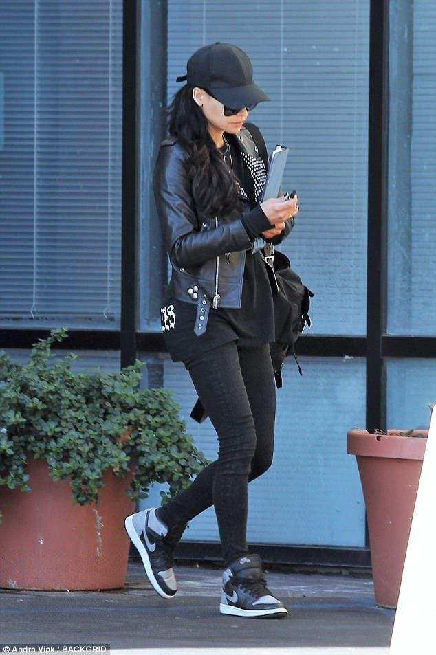 Focused: The Hollywood actress was focused on her phone as she made her way down the stree...