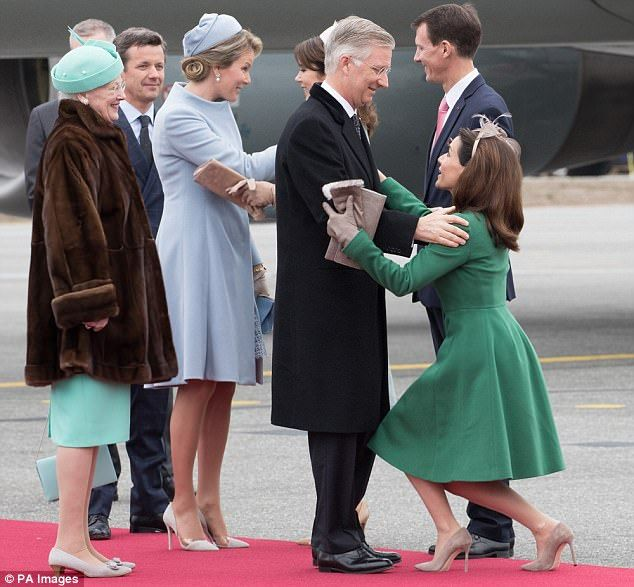 Queen Mathilde of Belgium touched down in Denmark for a state visit with her husband King Philippe, where she was greeted by Crown Princess Mary and other Danish royals.