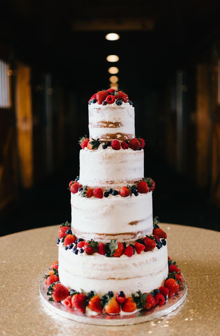 Naked cake, strawberries, blueberries, summertime wedding cake // Erin Morrison Photography