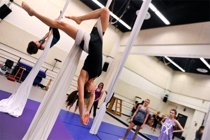 Increase your flexibility and change up your workout with silk aerial classes. Use yelp to find them locally! #silkclasses #funworkouts