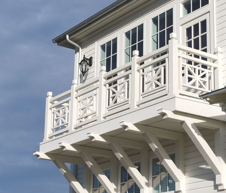 Balconies decks porches railings beach houses wood for Traditional balconies