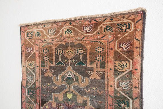 name: Kaveh style: hand knotted, Persian, rug, carpet material: wool colors: red, pink, peach, orange, chartreuse, green violet, navy, black, brown, camel, cream age: vintage condition: good, age related wear  39 x 58 (closest standard rug size is 3x5)  Please see pictures for detailed condition. There are more photos of this product available on our website HomesteadSeattle.com  We ship nationwide. Please contact us if youd like a more exact or combined shipping quote.
