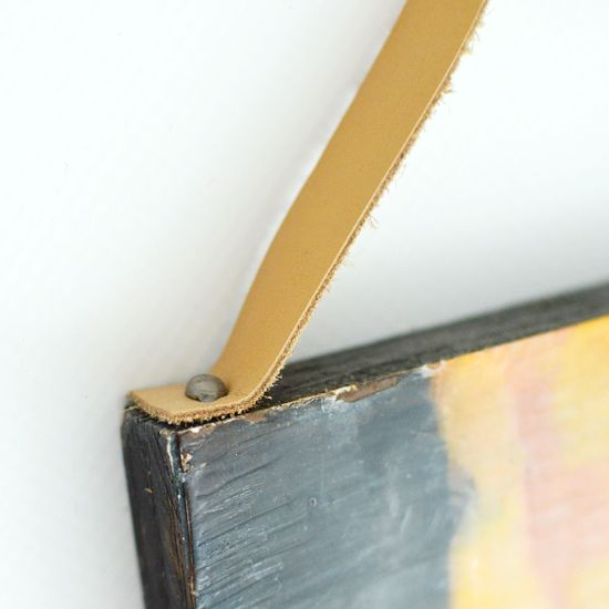 leather strap + upholstery tack picture hanger