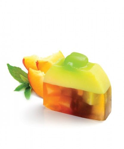 Tropical Fruit creative soap Inspired by the delicious fruit cake recipe,  this amazing colourful soap is a twist of all colours, shining so bright in a tropical design.  The topping fruits , existing of  mandarins, apples, blueberries and strawberries makes this soap pie looks so real and attractive.  Feel like in a paradise with this delicious recipe of tutti frutti accord blending of sun ripened raspberry with sliced pear notes, combined with mandarin juicy smells.