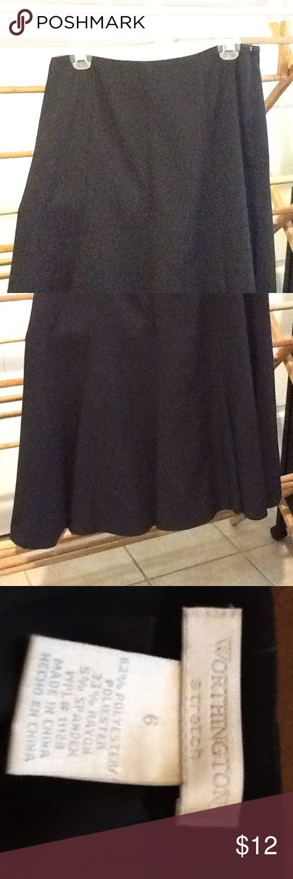 Women's Black Swing Skirt Size 6 Worthington Vintage size 6 black polyester, rayon and spandex swing skirt by Worthington stretch. Lined. Flared at the hem. Zipper on the side. In great condition. Worthington Skirts A-Line or Full