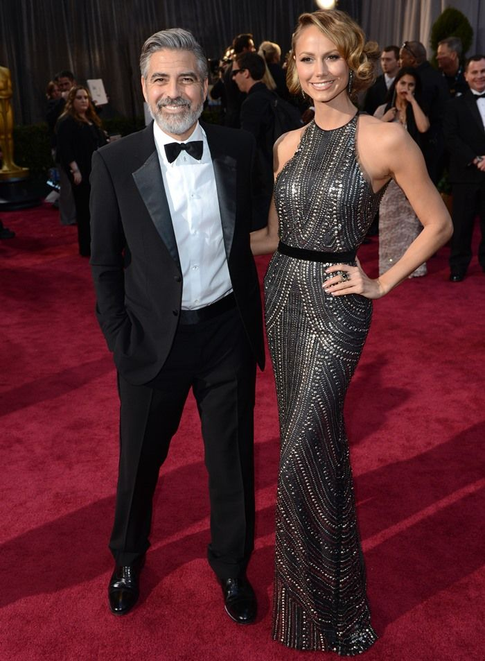 George Clooney and Stacy Keibler arrive at the Oscars at Hollywood & Highland Center on February 24, 2013 in Hollywood, California