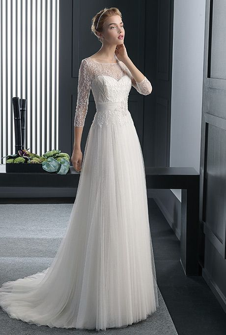 Brides: Two by Rosa Clará. Beaded lace and silken tulle dress in a natural color.