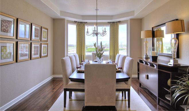 Hardwood Floors Bay Windows And Coffered Ceilings Shown In This Dining Room Are Just A Few Of
