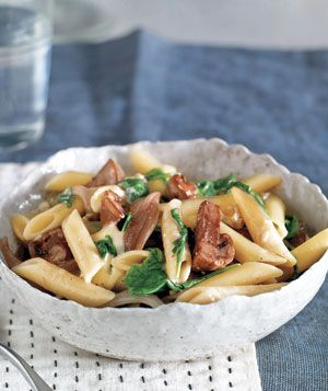 Pasta With Brie, Mushrooms, and Arugula | Get the recipe: http://www.realsimple.com/food-recipes/browse-all-recipes/pasta-with-brie-mushrooms-arugula-recipe-00000000023129/index.html