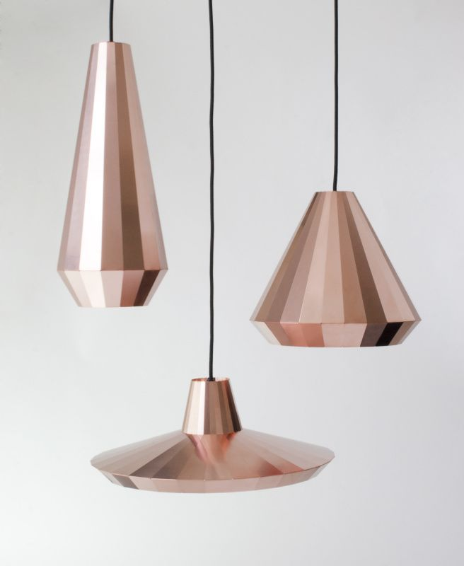 Copper Pendant Lamps by David Dersken Design. By reflecting its surroundings, each facet gets a different tone, from dark brown to red to orange. The material gives a warm color to the light that shines from these delicate lamps.