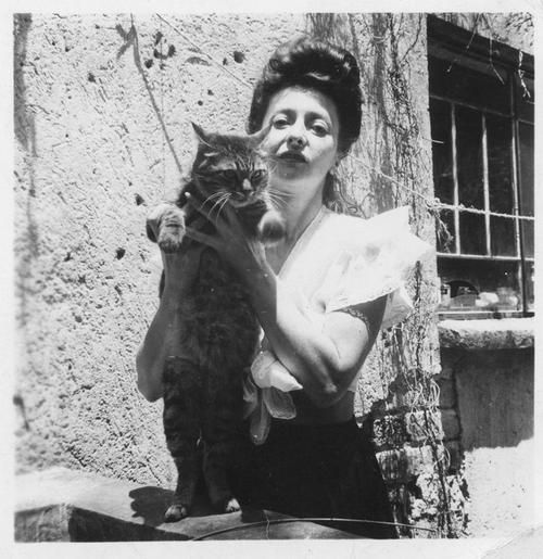 Spanish surrealist painter Remedios Varo (1908-1963) holding a cat in Mexico in an undated photograph taken by her lover Walter Gruen. Varo's work is most known today for its alchemical imagery.