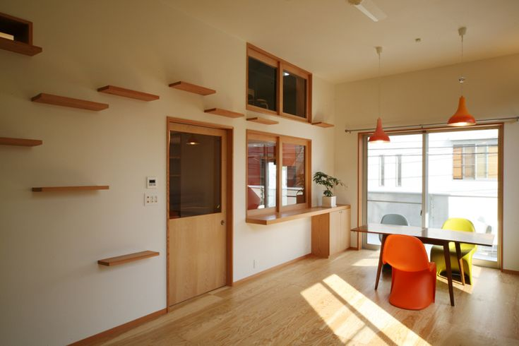 dining room with cat climbing shelves.  image by key operation inc.
