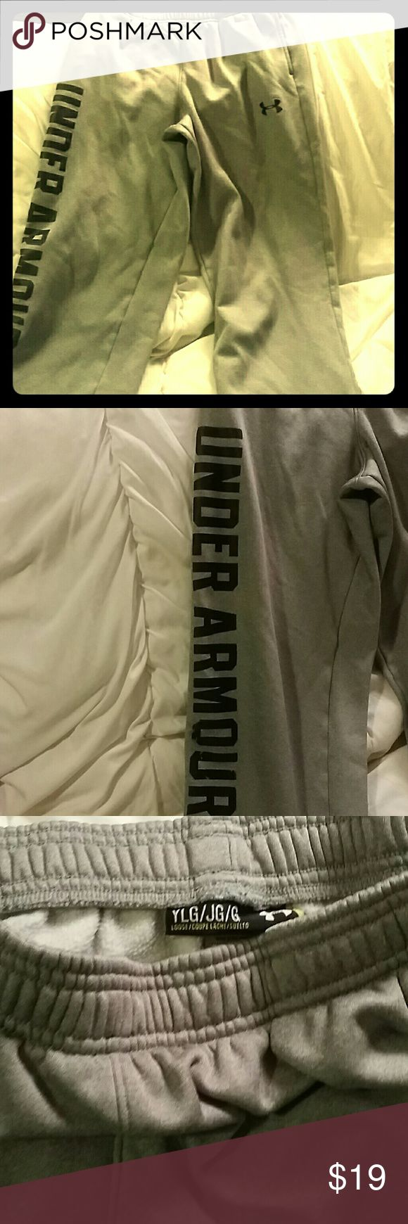 Youth Large Under Armour sweats athletic Gray with black letters and front pockets with elastic waist.  Good condition...boy or girl.  Sweats Under Armour Bottoms Sweatpants & Joggers