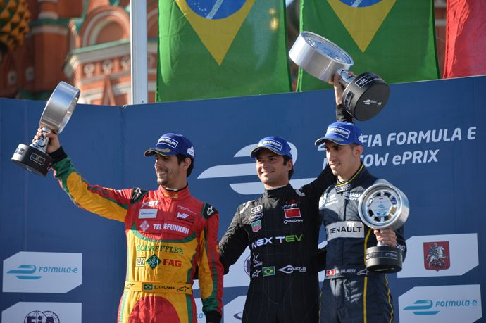 http://pronewsonline.com Winners of the FIA Formula E Championship in Moscow during the awarding ceremony. From left: Lucas di Grassi of the Audi Sport Abt team, second place; Nelson Piquet Jr. of the NEXTEV TCR team, first place, and Sebastien Buemi of the e.dams-Renault, third place. (RIA Novosti / Alexey Kudenko)