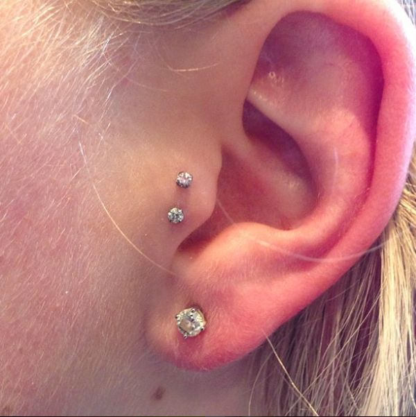 A double tragus piercing lends a unique touch to this classic lobe stud.  #refinery29 http://www.refinery29.com/2016/10/126285/body-piercing-constellation-la-trend-photos#slide-15