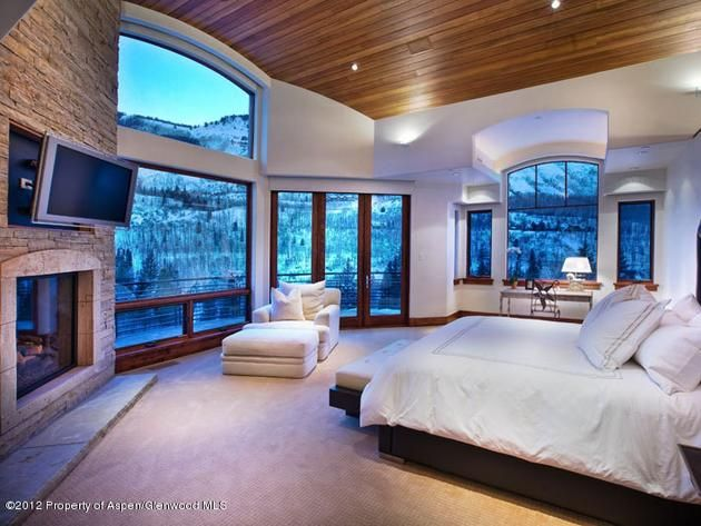 The #Neutral palette with dark wood accents really makes this #Bedroom blend with its beautiful #Views in this #MasterRetreat in #Aspen #Colorado
