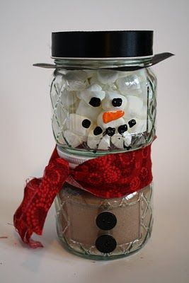 Hot cocoa snowman - love it!  She used two 1/2 pint canning jars and filled one with marshmallows and the other with cocoa.  The hat is made with paper (for the brim) and ribbon for the top.  Use buttons for the buttons and paint or vinyl for his face.  He is so adorable!