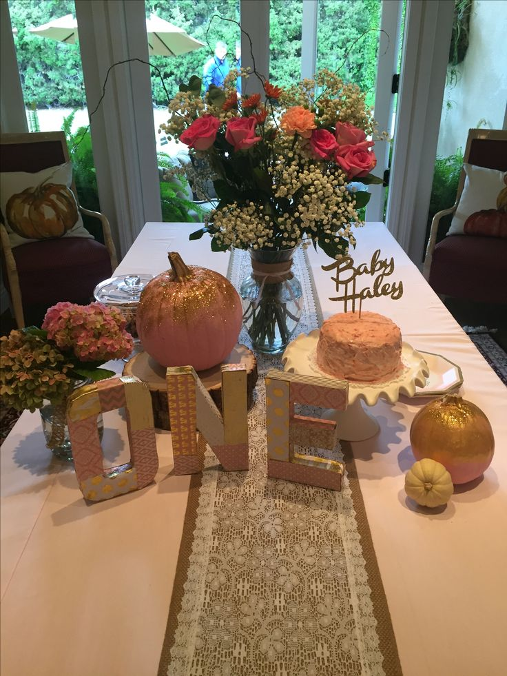 Pink and gold painted pumpkins for girls first birthday party in November