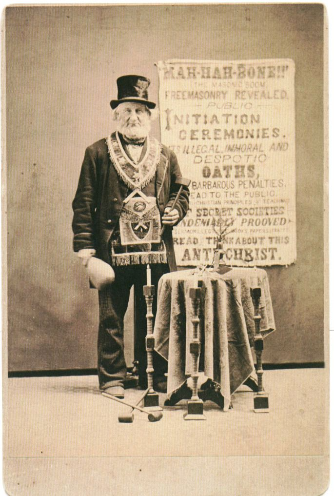 "This anti-Masonic protestor from 1870 has a sign decrying ""illegal, immoral, and despotic oaths."""