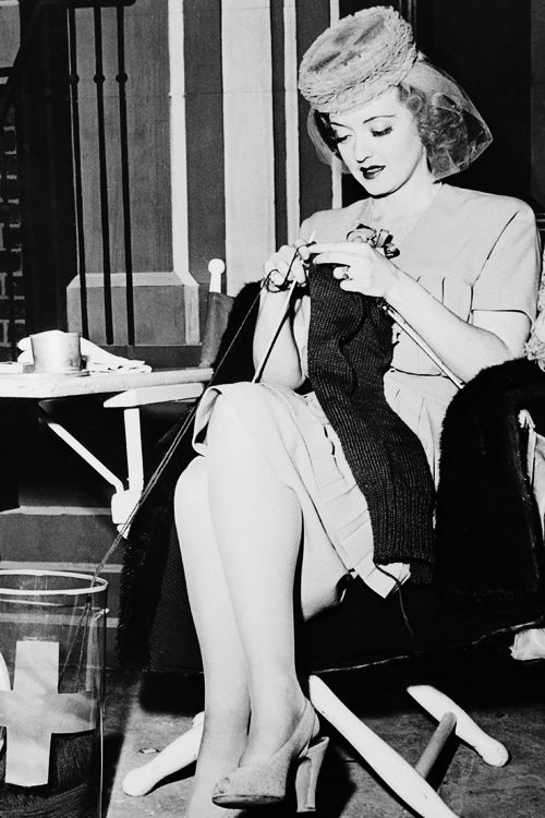 """Bette Davis knitting sweaters for the Red Cross on the set of """"In This Our Life"""" 1942"""