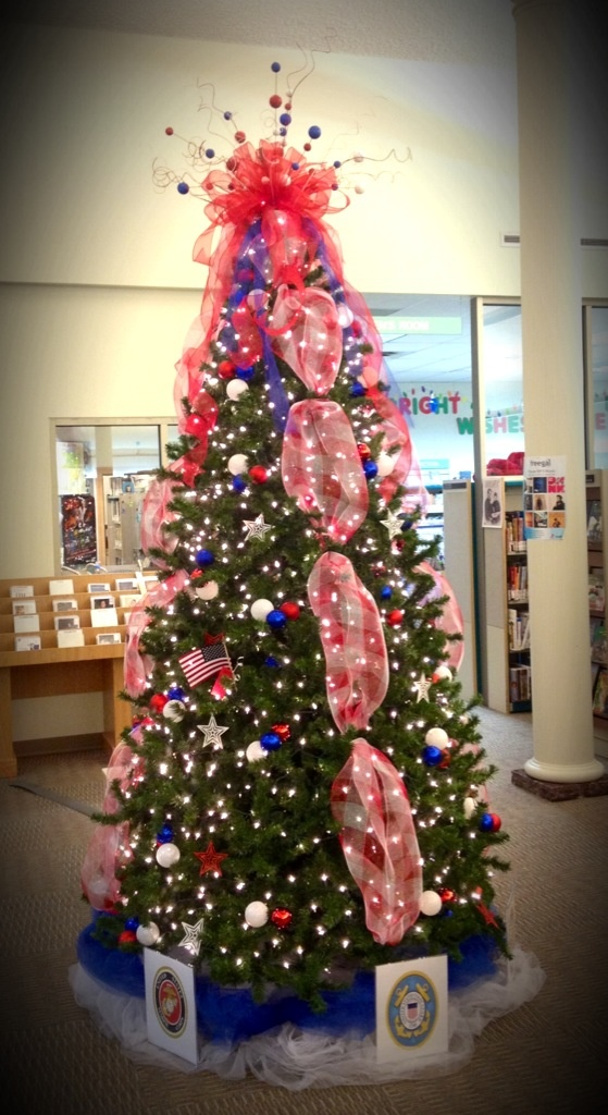 Visit the New Lexington Library this holiday season! In honor of our local veterans, the public is invited to visit the library and write the name of a veteran on a card, which will be attached to a small American Flag and placed on the Patriotic Christmas tree. The flags for the tree were donated by the Perry County Veterans Service Commission. Help us honor those who serve and have served.