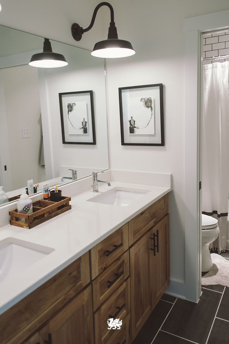 Modern Style Meets A Rustic Mood In A Bathroom Renovation That Pairs  Classic Wood Cabinetry With