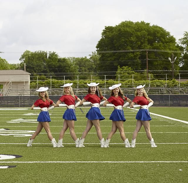 Five of the approximately 75 Kilgore College Rangerettes, a choreographed dance team that first formed in 1940 and now performs not only at football and other sports events at the small college in East Texas, but also appears at Dallas Cowboys professional football games and the annual Cotton Bowl college bowl game and at many other venues