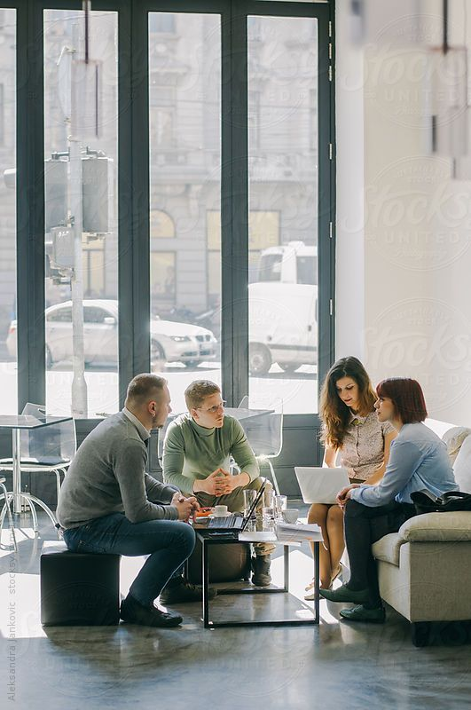 Young people in a business meeting by Alex | Stocksy United
