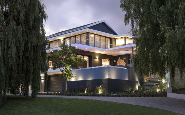 Daring project - set back on amazing site with willow tree. The house has a big rim flow pool and amazing lighting