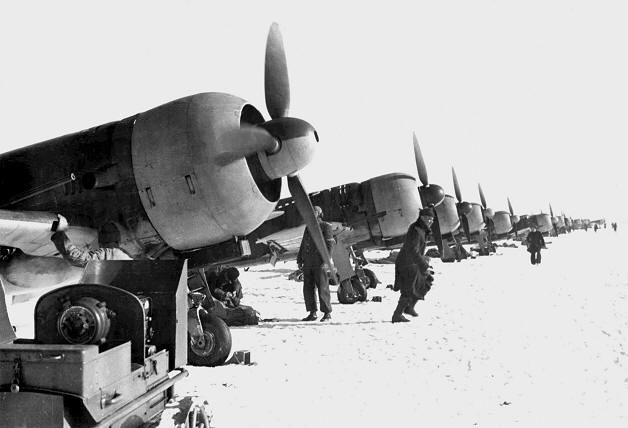Line of IAR 80Cs of Fl. 2 Vt. Gr. 6 Vt., on Popesti Leordeni Bucuresti Airfield, January 1944. Lower undercarriage covers were removed in winter conditions to avoid clogging the wheels with snow and mud.