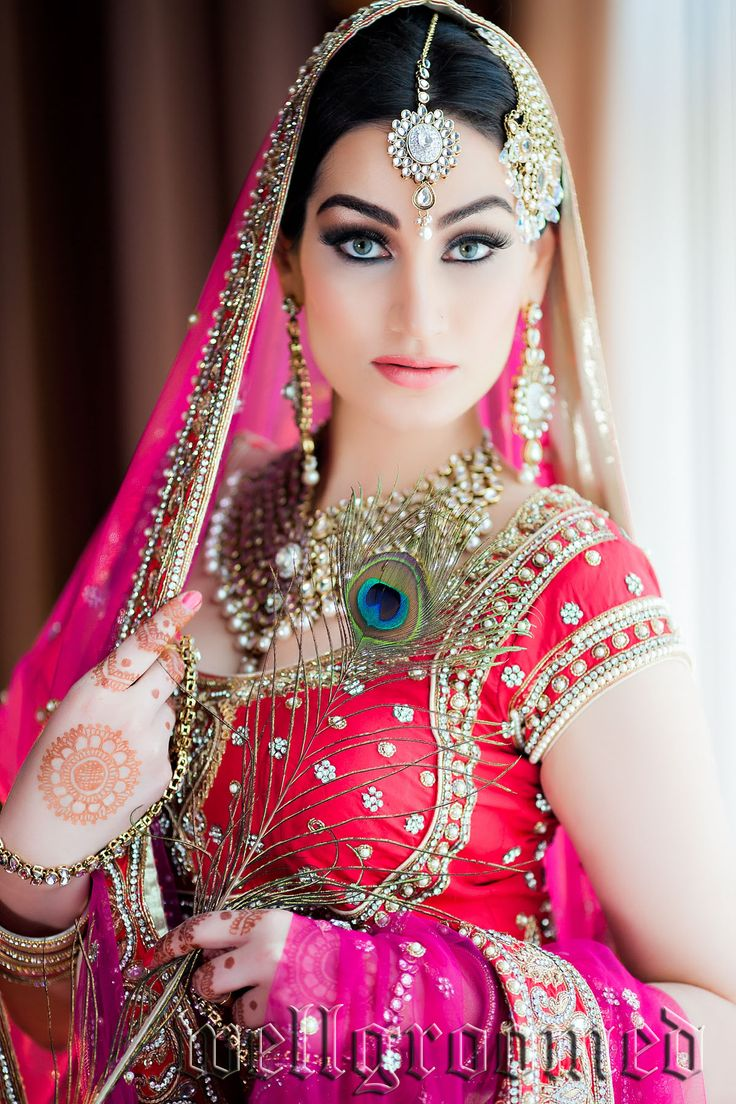 Beautiful Indian Bride Wearing Well Groomed Designer Lengha And Choli Peacock Eye Feather
