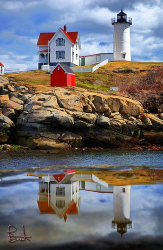 "'The Nubble' - photo by Brent Danley, via Flickr;  Lighthouse at Cape Neddick, Maine;  Cape Neddick is nicknamed ""the Nubble.""  The lighthouse was put into use in 1879. and is still in use today.  It stands 41 feet tall but the light is 88 feet above sea level because of the additional height of the steep rocky islet on which it sits.   - Wikipedia"