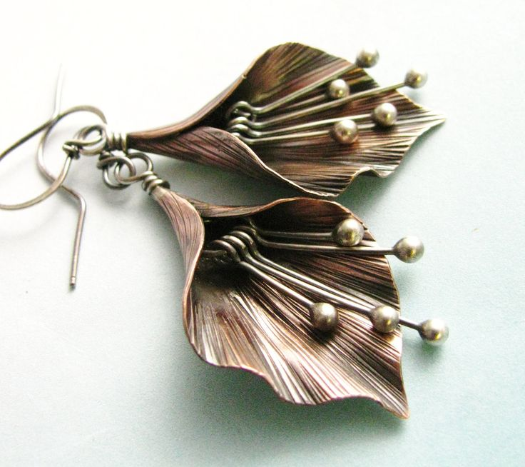 Earrings | Sabrine & Dante Acevedo ~ Mocahete Designs.  Sterling silver and copper.
