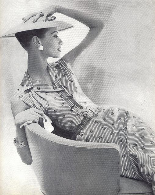 1955 Vogue, elegant woman, hat and dress
