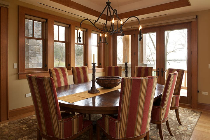 Dining room with Pinnacle clad casement, awning, direct set, and swinging patio doors by Windsor Windows & Doors. www.windsorwindows.com