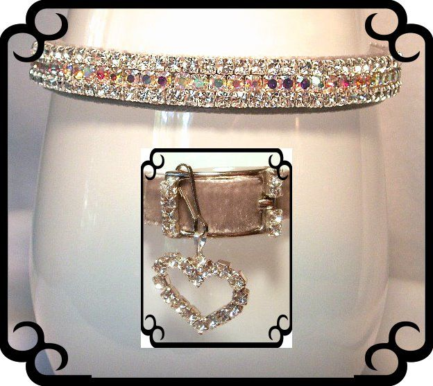 "This fancy dog collar is 5/8"" wide.  It has  white Swarovski crystals on it as well as a gorgeous  Gray/Silver  velvet ribbon.  The rhinestone buckle & charm are included."